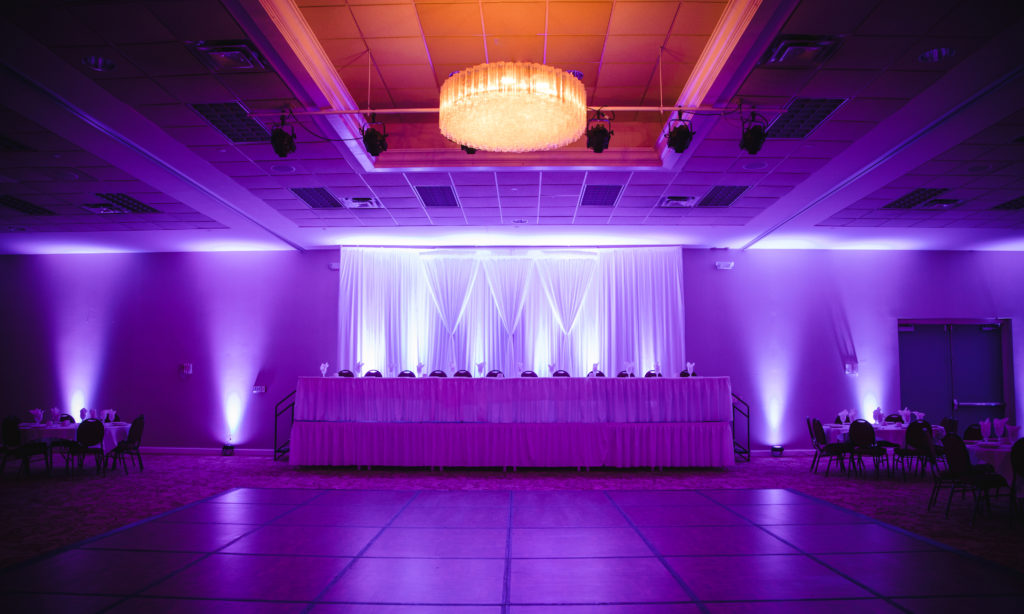 Chance Productions - Janesville Conference Center - Janesville, WI uplights, drape, backdrop, head table, ballroom, wedding, lighting,